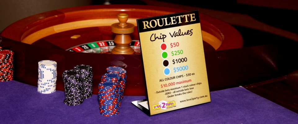 Roulette sign wheel blackjack casino party hire
